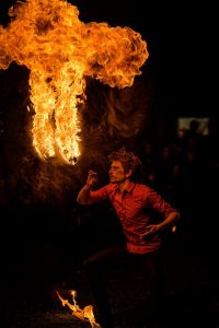 Fire performer breathing fire