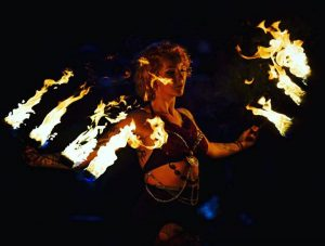 Fire performer holding fire